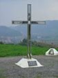 Memorial cross in honour to Gordan Lederer, with a view to Kostajnica and river Una